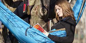 ASU student reading in hammock