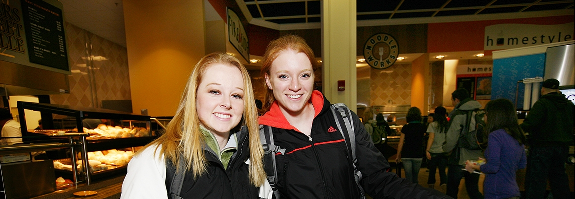 Two female ASU students smiling